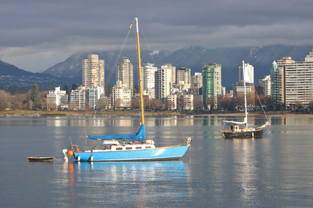 Privately owned recreational sailboats are anchored in English Bay, open ocean waters on Canadas west coast Stock Photo