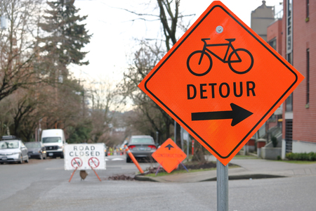 road cycling: An English sign warns cyclists that there is a detour on the road.