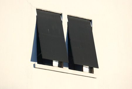 awnings windows: Two Outdoor Industrial Windows and Awnings