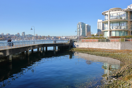 False Creek architectural planning included public walkways and bridges surrounding the area Stock Photo