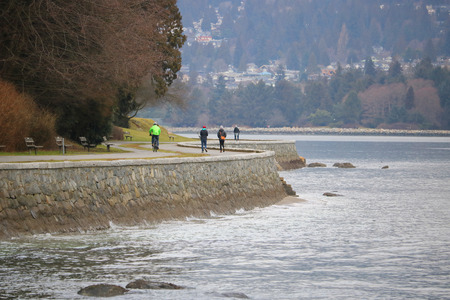 People enjoy a scenic stroll or cycle around the seawall in Vancouvers Stanley Park
