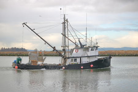 weigher: A Seine or Seine-Haul Boat carries a bulk weigher used for measuring fish that is freshly caught. Stock Photo