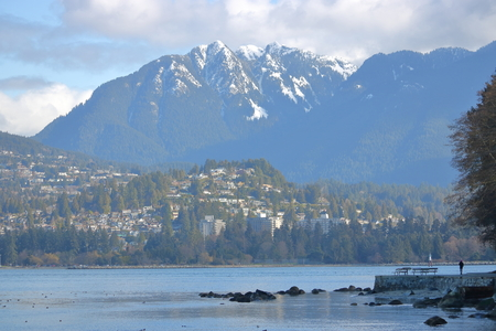 The Stanley Park seawall overlooking the Burrard Inlet and Cypress Mountain.