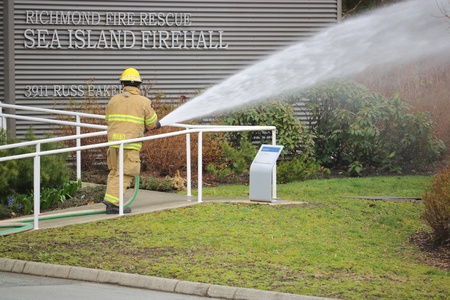 A fireman with the Richmond Fire and Rescue Detachment in Richmond, British Columbia uses a fire hose while testing essential equipment on March 23, 2017.
