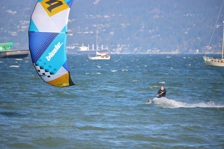 traction: Strong winds on Vancouver, Canadas English Bay make for ideal kite surfing on April 02, 2017. Editorial