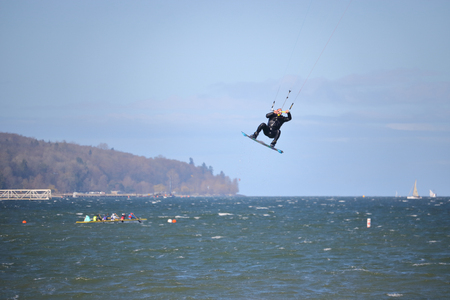 A Kite Surfer launches high into the air with the help of gale force winds on English Bay in Vancouver. Canada on April 2, 2017. Editorial