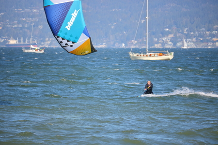 major force: Kite Surfing on English Bay and a seasoned veteran with his kite catches major gale force winds in Vancouver, Canada on April 2, 2017.
