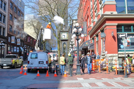 cleaning crew: Wide on city work crew cleaning and fixing the famous steam clock in Vancouvers Gastown district in preparations for the busy tourist season on April 11, 2017. Editorial