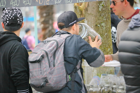 A man smells a jar full of marijuana at Vancouvers annual 4-20 day. Editorial