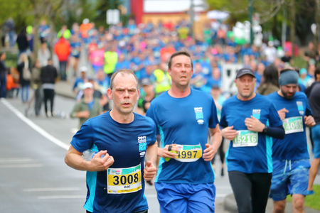 Stress and strain is etched on athletes' faces as  about 40,000 runners competed in 2017 Vancouver Sun Run in Vancouver, B.C., April 23, 2017. Banco de Imagens - 76811471