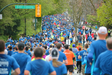 About 40,000 runners competed in the 2017 Sun Run Race in Vancouver, B.C. on April 23, 2017. Banco de Imagens - 76811472