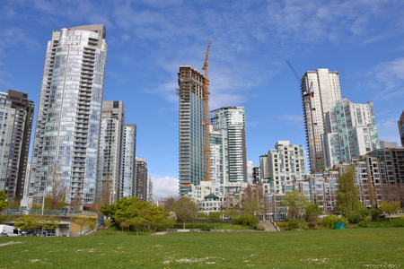 Green space is provided in a high density area of Vancouver, Canada. Редакционное