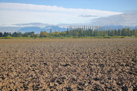 A freshly plowed farmers field is now ready to be seeded.