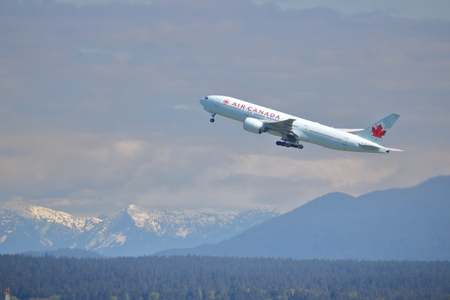An Air Canada passenger jet leaves Vancouver's YVR Airport on May 04, 2017. Editoriali