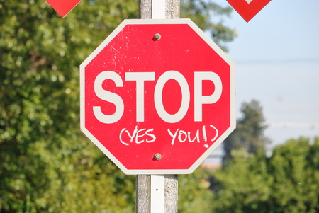 Close on an English stop sign imploring people to stop. Stock Photo