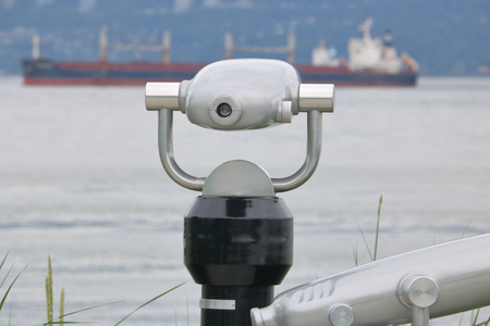 A telescope allows the public to view ships in the harbor.