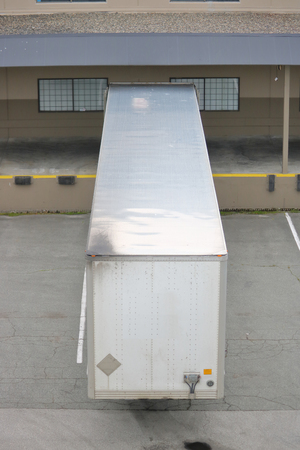 High angle view of a typical loading bay and trailer for delivering goods.