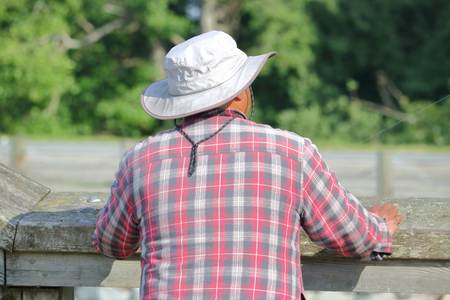 A typical North American casual hat worn by men in the summer.