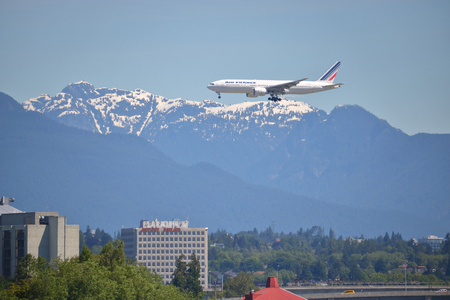 approaches: An Air France passenger jet carrier approaches YVR airport in Vancouver, British Columbia on June 24, 2017. Editorial