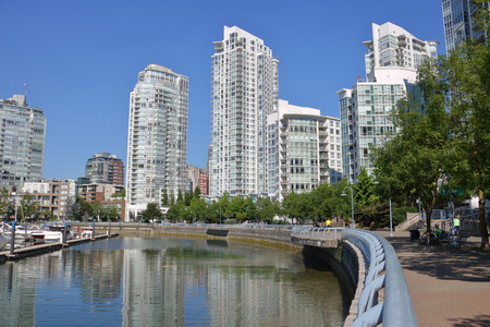 A promenade or foot path for pedestrians that winds around the north side of False Creek in downtown Vancouver, Canada. Stock Photo