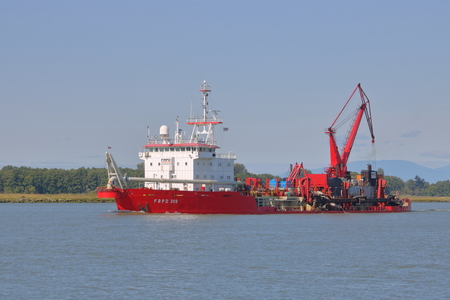 A Trailing suction hopper dredger is used on the Fraser River near Vancouver, British Columbia to clear silt and debris on July 15, 2017.