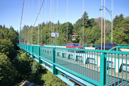 Looking south at the midway point of the Lions Gate or First Narrows Bridge to Stanley Park in Vancouver, BC, Canada.