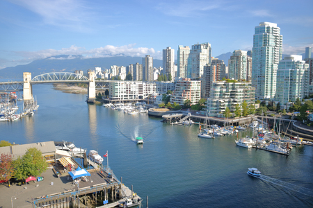 A high angle view of the west side of Vancouvers False Creek and its entrance via the Burrard Street Bridge.
