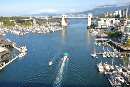 Vancouver, British Columbia is a popular destination for travelers to visit a major city by the oceanfront.