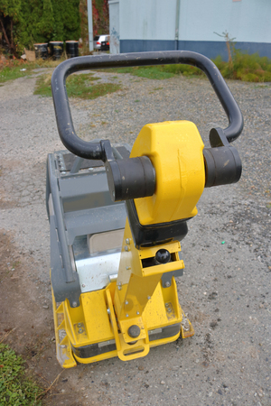Overhead view of a compactor used to harden and compact earth for landscaping.