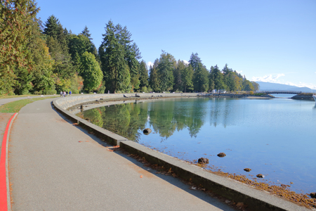 A pedestrian and cycling path surrounds Vancouvers  Stanley Park on Canadas scenic west coast.