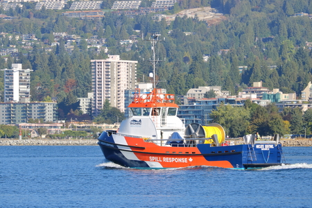 An oil spill response vessel heads out from the harbor to investigate an incident near Vancouver, British Columbia on September 11, 2017. Editorial