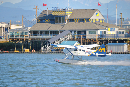 A Harbour Air passenger plane passes the terminal as it takes off in Richmond, British Columbia on September 4, 2017.
