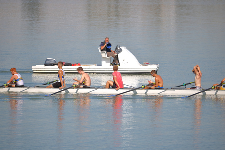 The University of British Columbia rowing works with his athletes on the Fraser River near Vancouver, British Columbia on September 16, 2017.