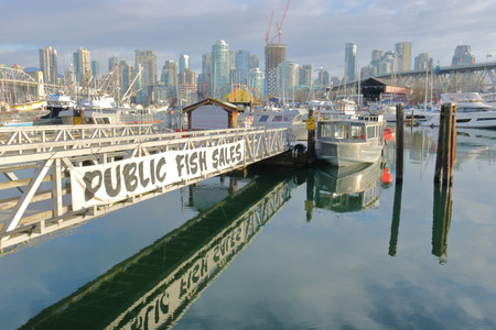 A banner draws attention to an area in Vancouver, Canada where fish is sold in an outdoor public market. Editorial