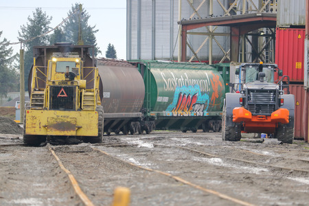 Heavy industrial machinery is used to deliver grain shipped in rail cars to a giant bin for export in Richmond, British Columbia on January 10, 2018. Editorial