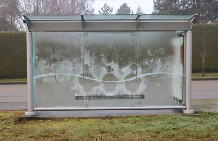 The frost outline of three bodies pressed against a glass bus shelter on a cold winters day. Stock Photo