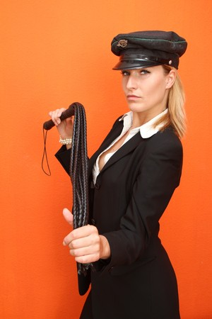 Woman with leather whip photo