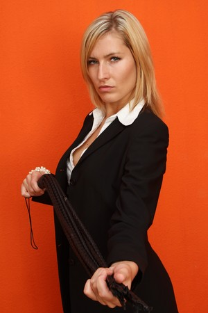 Woman with leather whip Stock Photo - 7906901