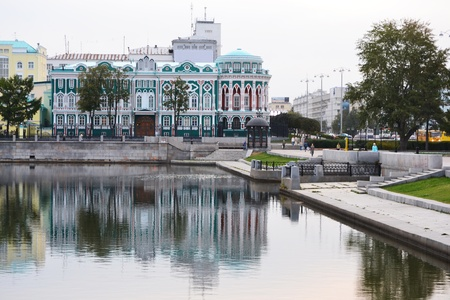 eclecticism: Beautiful historical building at the bank of city pond in Yekaterinburg, Russia Editorial