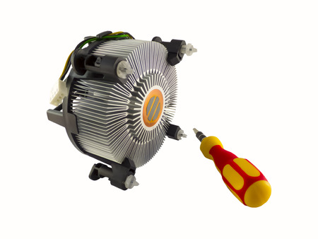 Processor heatsink cooler fan and screw-driver isolated on white background photo