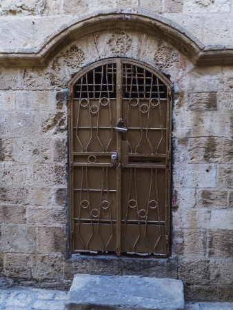 Metal door on old street in Jaffa, Tel-Aviv, Israel  photo