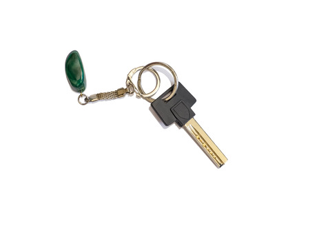 fob: House key with key ring and malachite fob on white