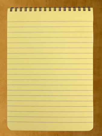 legal pad: Blank spiral bound yellow legal pad on office desk