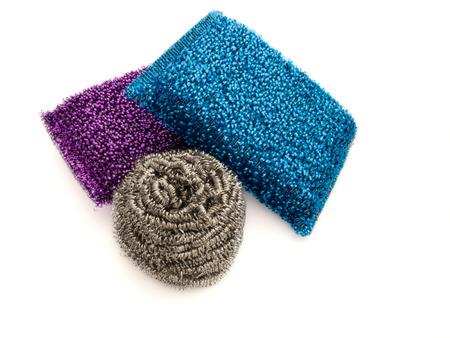 scouring: Three metallic colored kitchen sponges on white background. Stock Photo