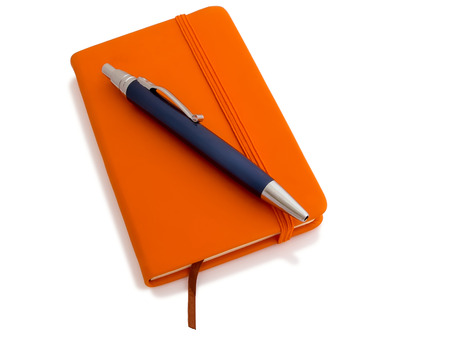 Note book with ballpoint pen isolated on white background