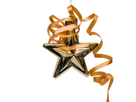 Gold Christmas star with ribbon. Isolated on white
