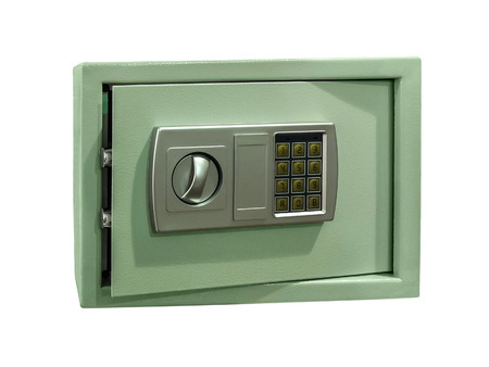 Small safe for home and office use with digital lock isolated on white. photo