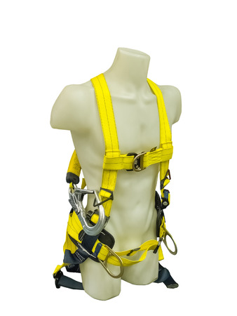 security safety: Mannequin in safety harness equipment on a white background
