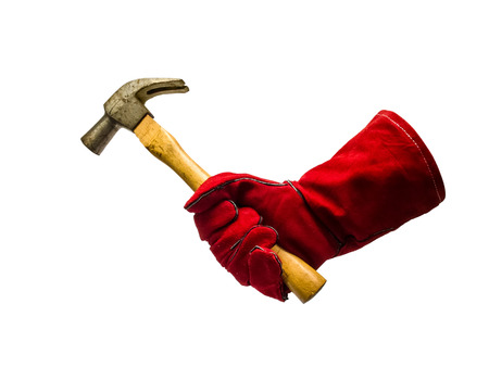 Protective glove holding hammer. Isolated on a white background photo
