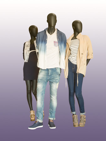 Three mannequins dressed in casual clothes. Isolated on color background